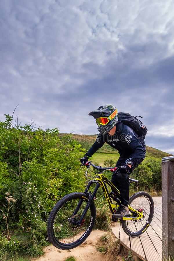 Free A Mountain Bikers Wearing Safety Gears Jumping Downhill, Etretat, France Royalty Free Stock Image - 175452866