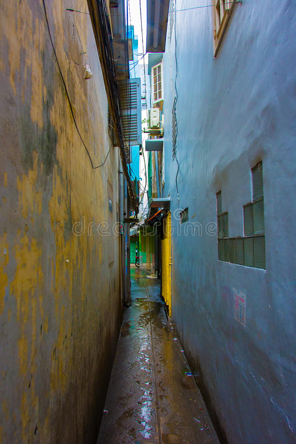 Free A Narrow, Colorful, Dark Alley In Between Two Buildings With Open Windows And Shutters. Stock Photo - 50881980