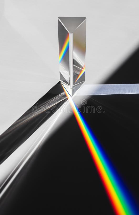 Free A Prism Dispersing Sunlight Splitting Into A Spectrum On A White Background. Stock Image - 111047641