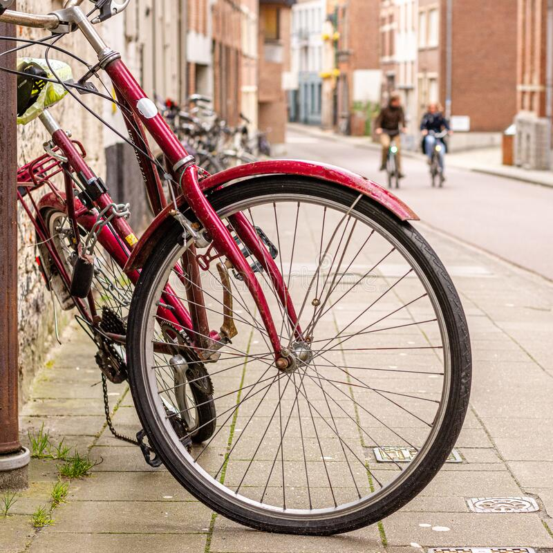 Free A Red Bike In The Foreground, Fun Bike Ride In The Background Royalty Free Stock Images - 174702589