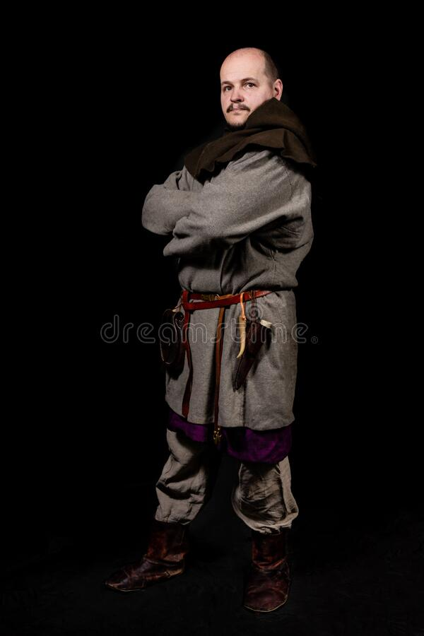 Free A Resident Of A Medieval Settlement Crossed His Arms Over His Chest, Looks Doubtfully. A Lover Of Living History Poses In The Clot Royalty Free Stock Photography - 172720487