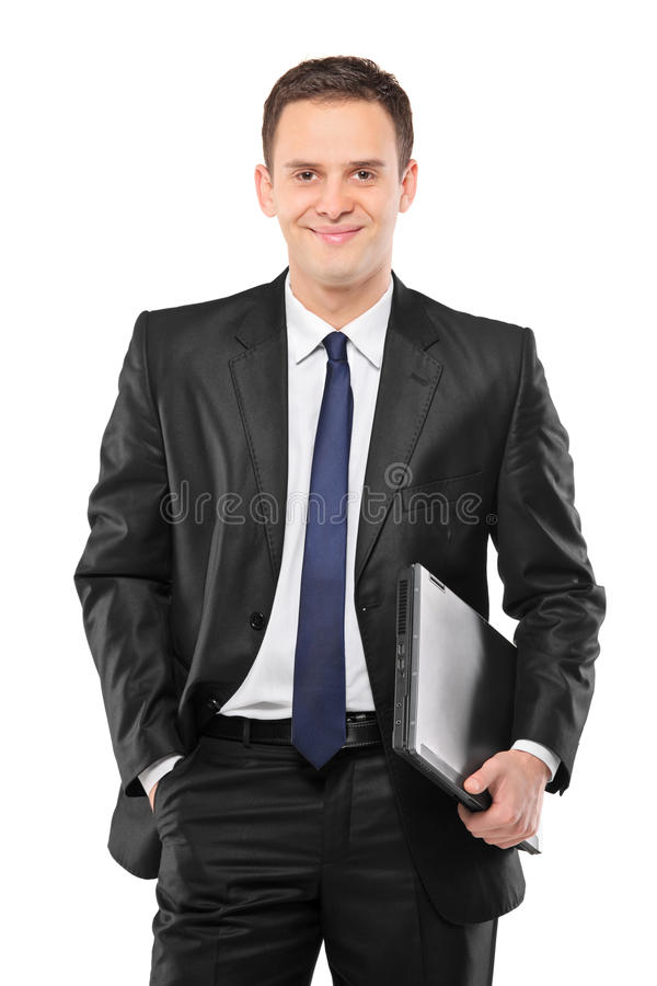 Free A Smiling Businessman Holding A Laptop Royalty Free Stock Photo - 18057965