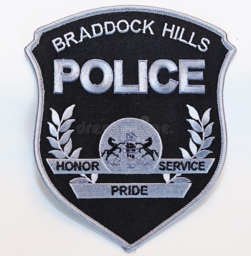 Free A Subdued Black And Silver BRADDOCK HILLS POLICE Shoulder Patch On A White Background Royalty Free Stock Photography - 134219147