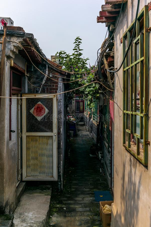 Free A View Of A Narrow Alley In A Traditional Beijing Hutong In Chin Royalty Free Stock Images - 129356379
