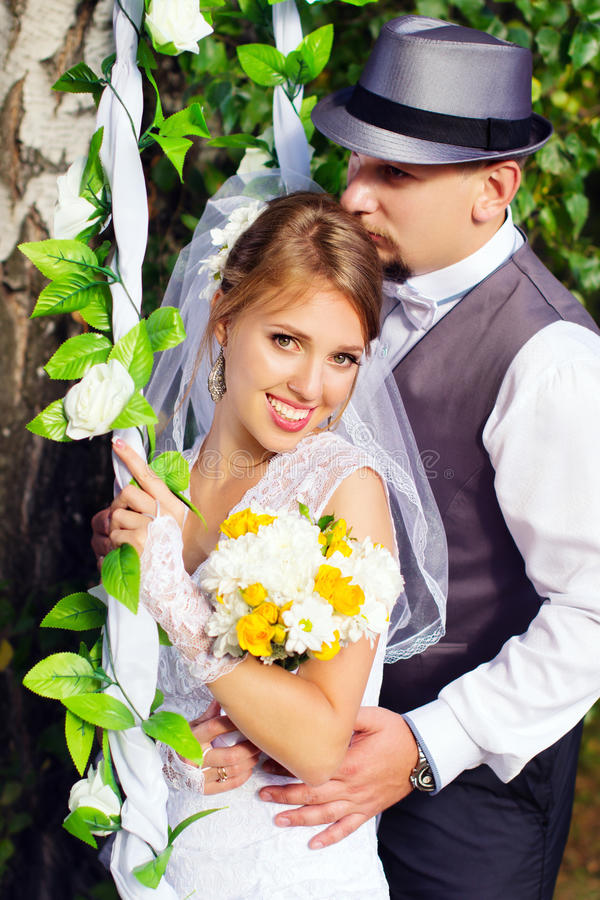 Free A Wedding, Bride And Groom Swinging On A Swing Royalty Free Stock Photo - 50891825