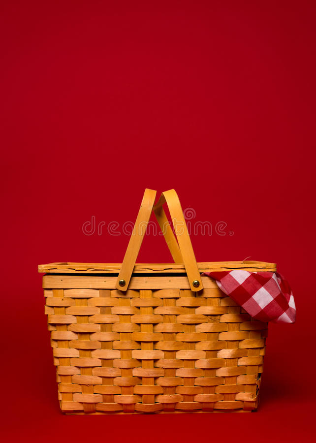 Free A Wicker Picnic Basket With Red Gingham Tablecloth On A Red Back Royalty Free Stock Photo - 37987715