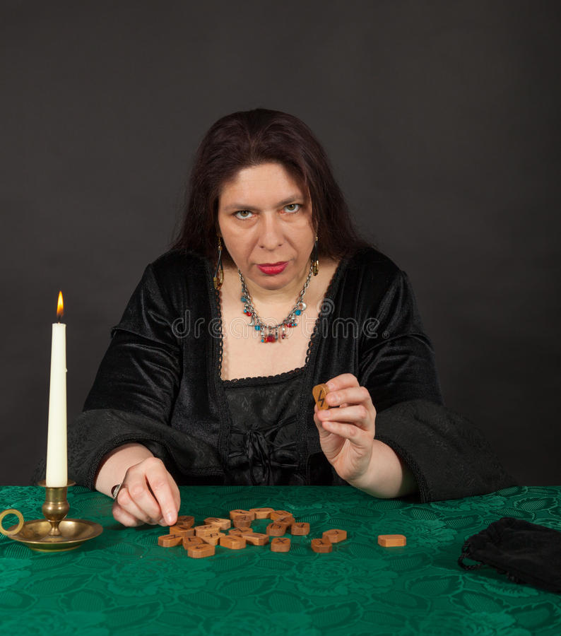 Free A Woman Is Telling The Future With Runes Stock Images - 27682474