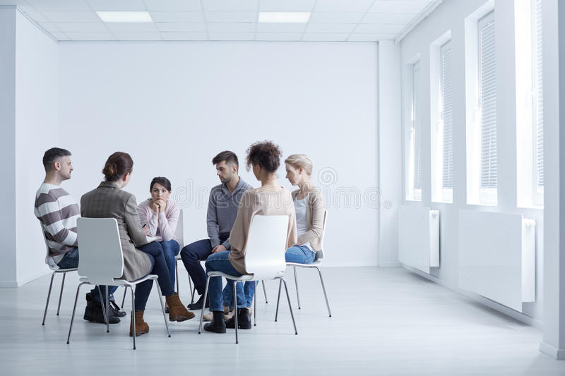 AA group meeting. People sitting in circle during AA group meeting royalty free stock photos