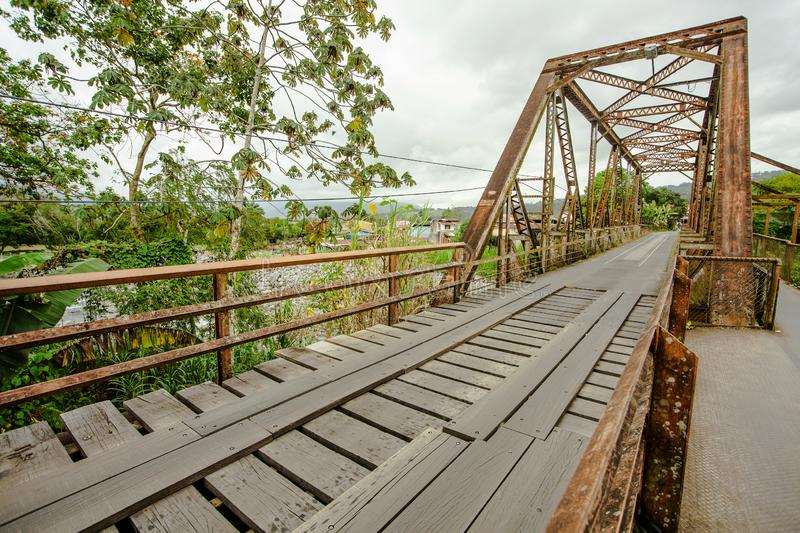 Steel bridge over a river in Costa Rica royalty free stock photo