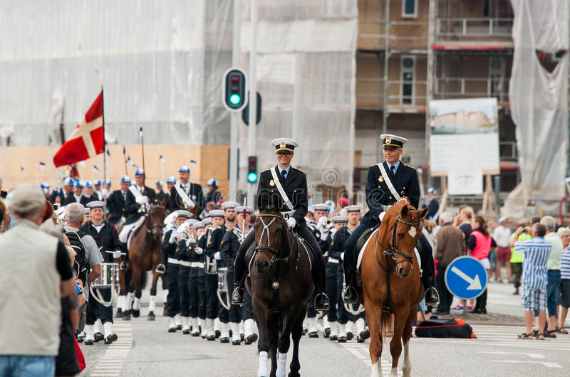 AABENRAA, DENMARK - JULY 6 - 2014: Police escort at a parade at. The annual tilting festival in Aabenraa royalty free stock image