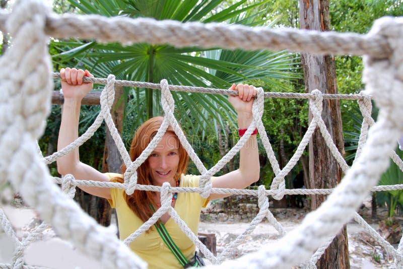 Download Aadventure Woman On Jungle Rope Bridge Stock Photo - Image: 19920212