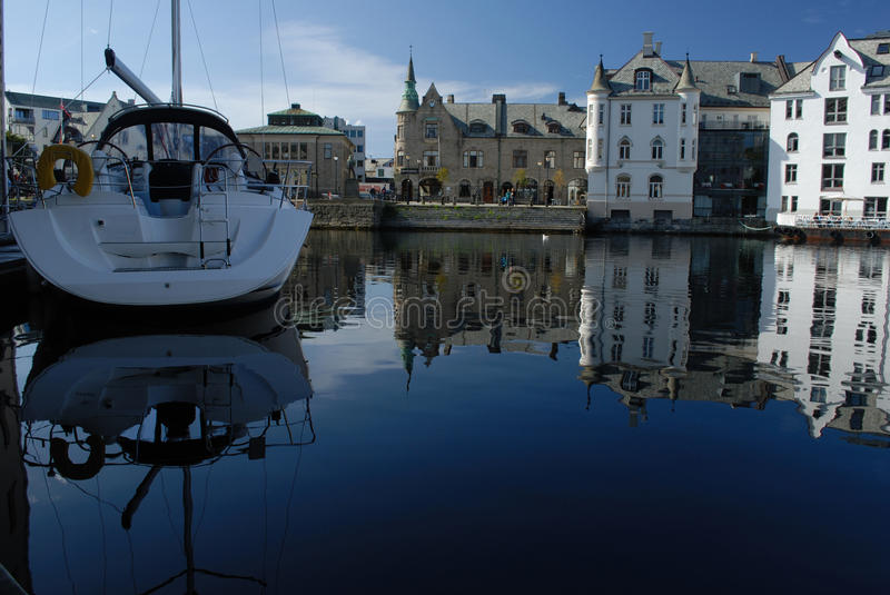 Aalesund in Norway. Boat in a coastal town - Aalesund royalty free stock photography