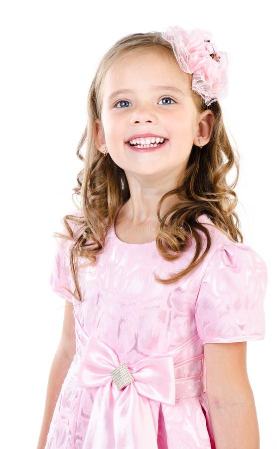 Aanbiddelijk glimlachend meisje in roze geïsoleerd prinseskleding royalty-vrije stock fotografie