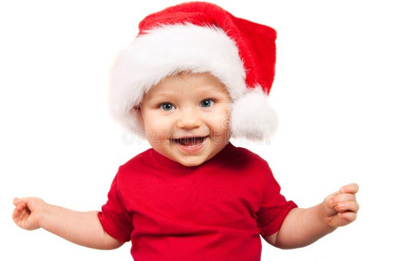 Aanbiddelijk Kerstmiskind in een rode hoed royalty-vrije stock foto's