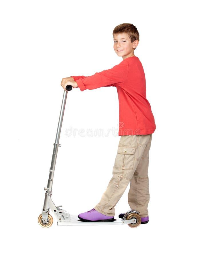 Aanbiddelijk kind op skateboard stock afbeelding