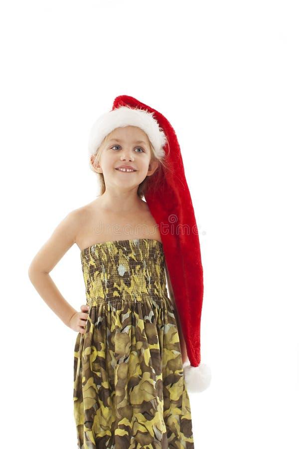 Aanbiddelijk meisje in rode Kerstmanhoed Het meisje van Kerstmis royalty-vrije stock afbeeldingen