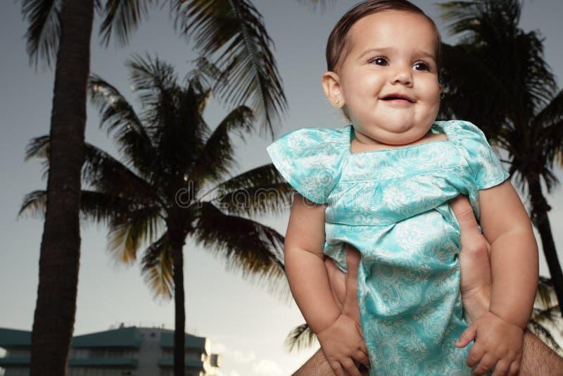 Aanbiddelijke baby die wordt gehouden royalty-vrije stock afbeelding