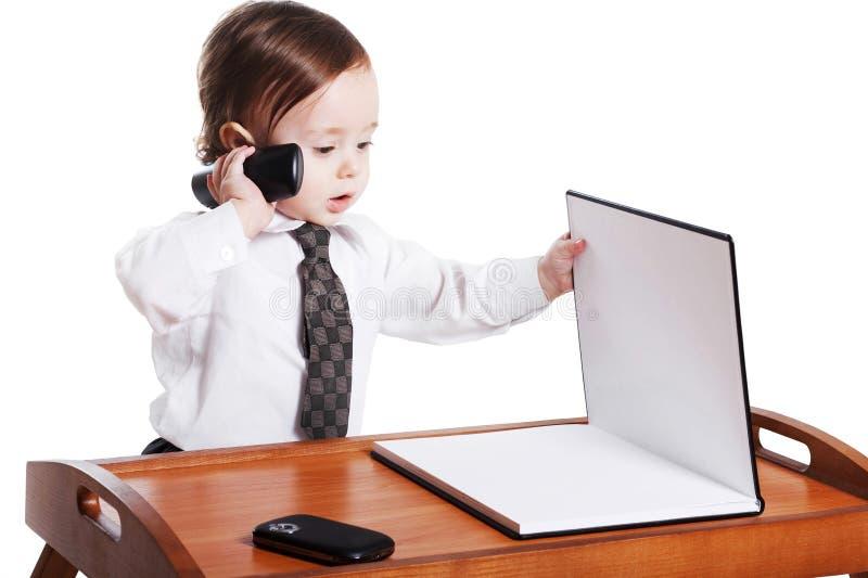 Aanbiddelijke babyzakenman met telefoon royalty-vrije stock afbeelding