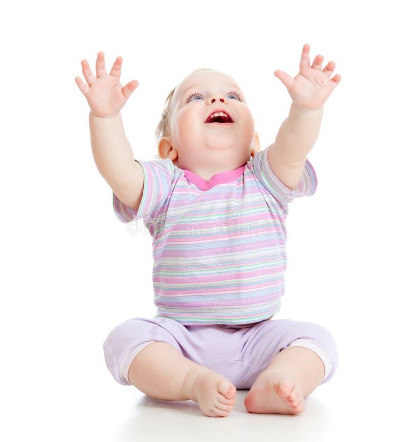 Aanbiddelijke gelukkige jongen die omhoog op wit kijkt royalty-vrije stock fotografie