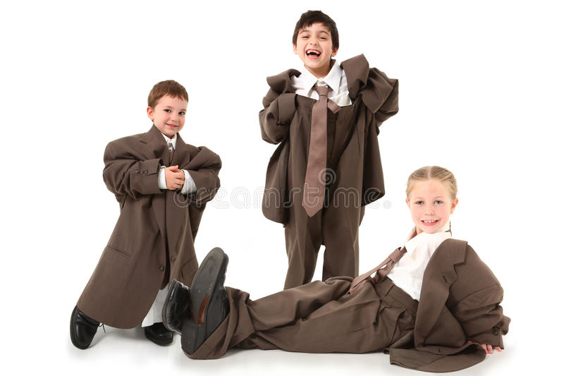 Aanbiddelijke Jonge geitjes in over Met maat Kostuums stock foto's