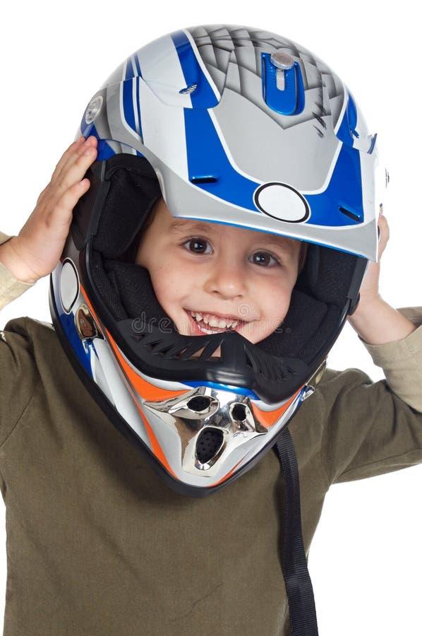 Aanbiddelijke jongen met een helm in het hoofd stock afbeeldingen