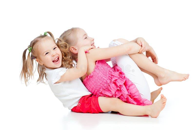 Aanbiddelijke kinderen die grappig goed tijdverdrijf hebben stock foto's