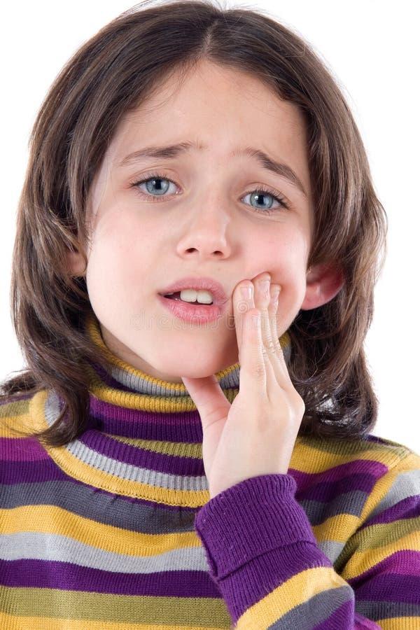 Aanbiddelijke meisjeswhit tandpijn stock fotografie