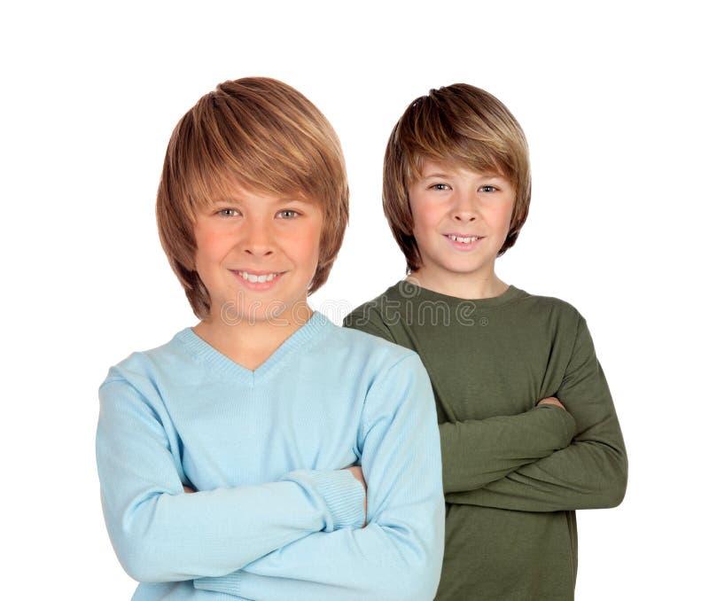 Aanbiddelijke tweelingen stock foto