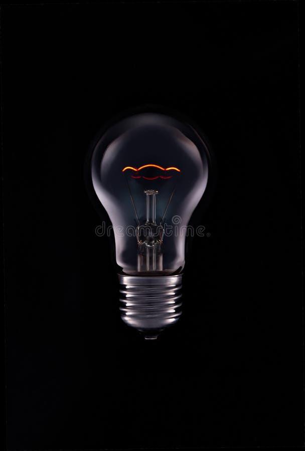 Aangezette bollamp, zwarte achtergrond royalty-vrije stock foto