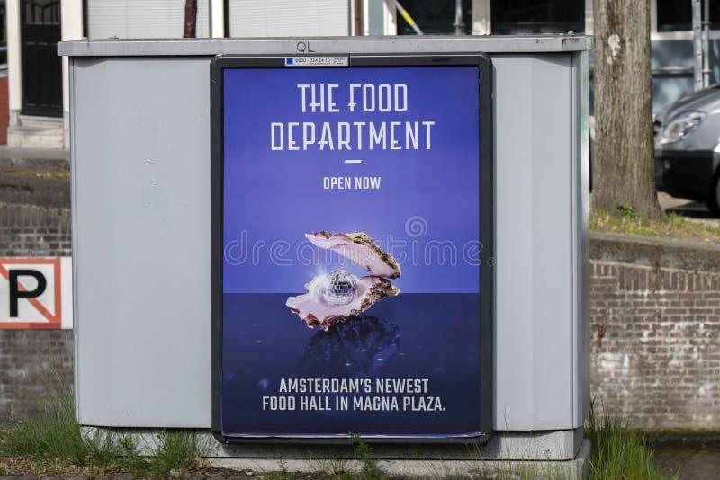 Aanplakbord de Voedselafdeling Magna Plaza New Food Hall bij het Nederland 2019 van Amsterdam royalty-vrije stock afbeelding