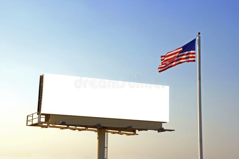 Aanplakbord en Amerikaanse Vlag stock afbeelding