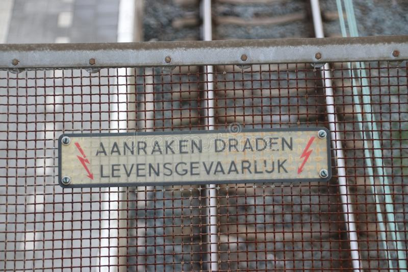 `aanraken draden Levensgevaarlijk` warning sign which means `dangerous touching wires` stock photo