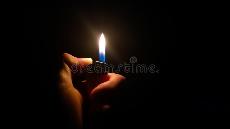 Aansteker in een Hand royalty-vrije stock afbeeldingen