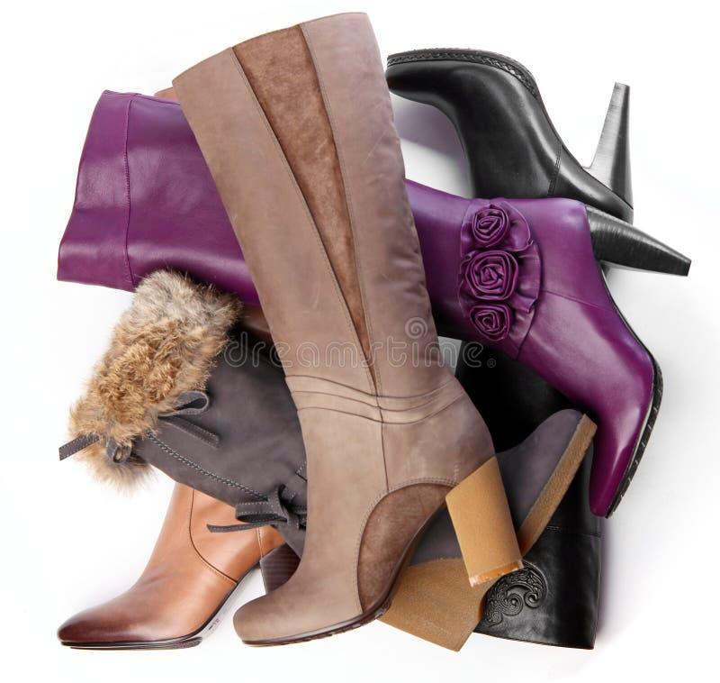 Aantal high-heeled vrouwelijke laarzen stock foto