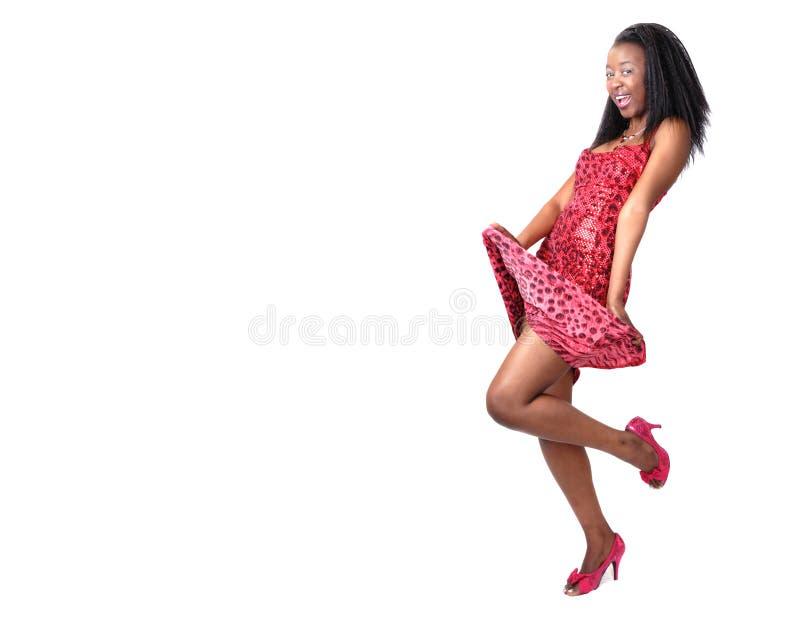 Aantrekkelijk Afrikaans meisje in rood royalty-vrije stock foto