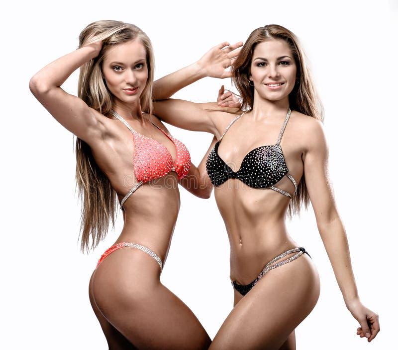 Aantrekkelijk atletisch meisje twee royalty-vrije stock afbeelding