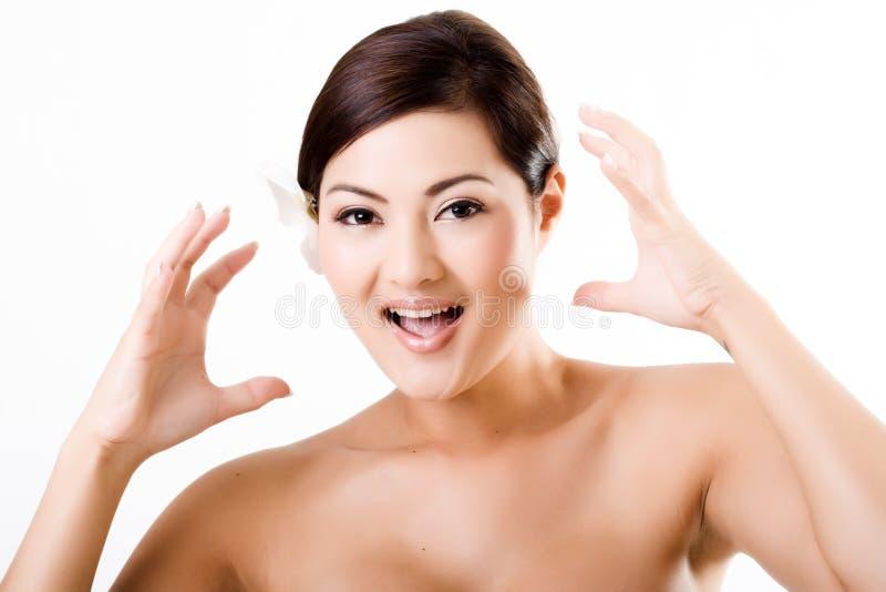 Aantrekkelijk Aziatisch wijfje dat verrast gezicht toont stock afbeeldingen