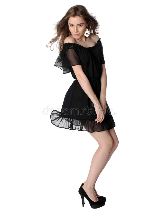 Aantrekkelijk geïsoleerd meisje in een weinig zwarte kleding stock afbeeldingen