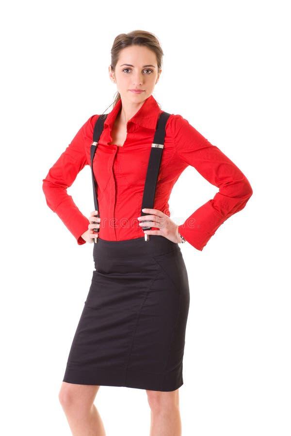 Aantrekkelijk geïsoleerde wijfje in rode overhemd en steunen, royalty-vrije stock afbeeldingen