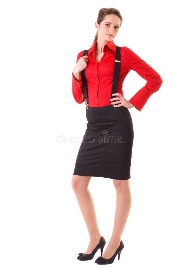Aantrekkelijk geïsoleerdn wijfje in rode overhemd en steunen, royalty-vrije stock fotografie