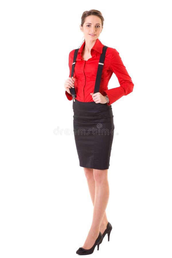 Aantrekkelijk geïsoleerdn wijfje in rode overhemd en steunen, stock fotografie