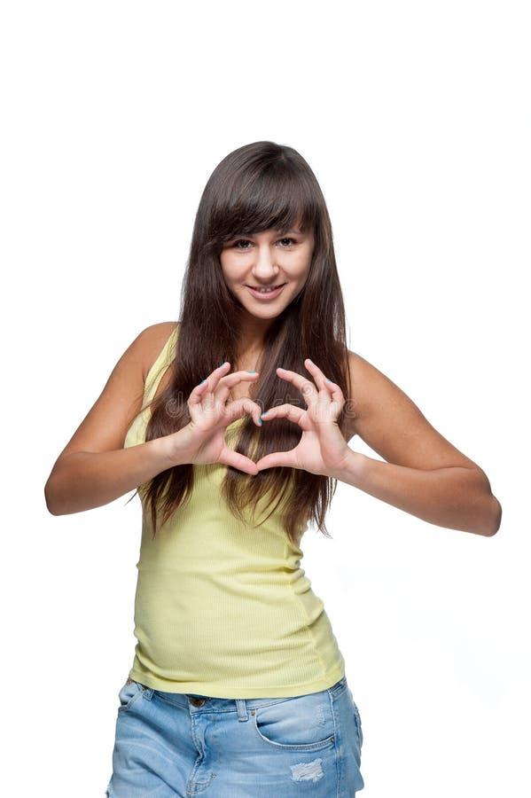Aantrekkelijk Kaukasisch meisje die hart tonen royalty-vrije stock foto's
