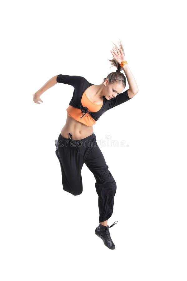 Aantrekkelijk meisje dat in de lucht springt stock foto