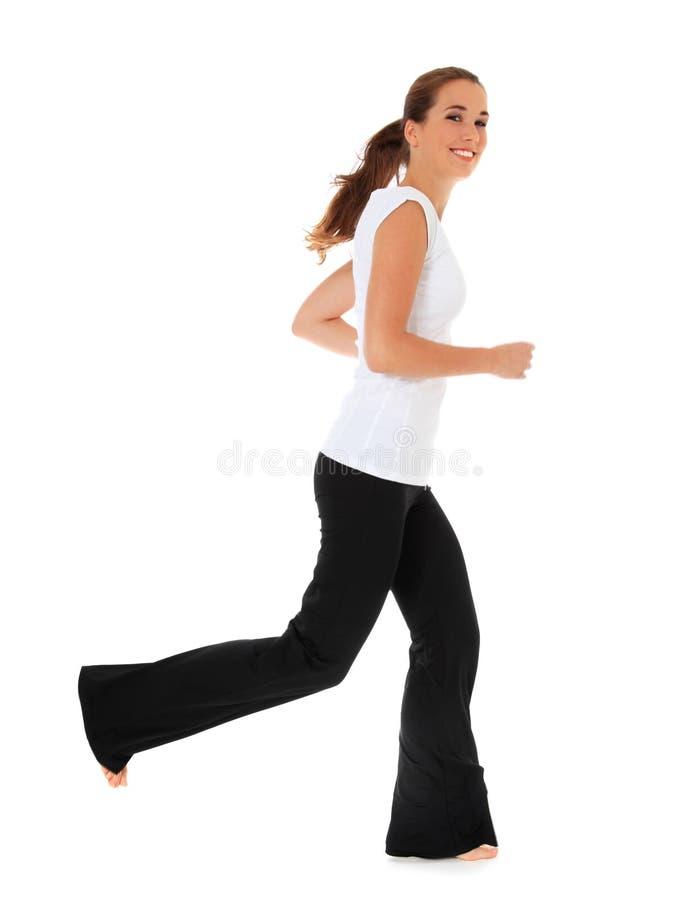Aantrekkelijk meisje in sportenslijtage het lopen stock fotografie