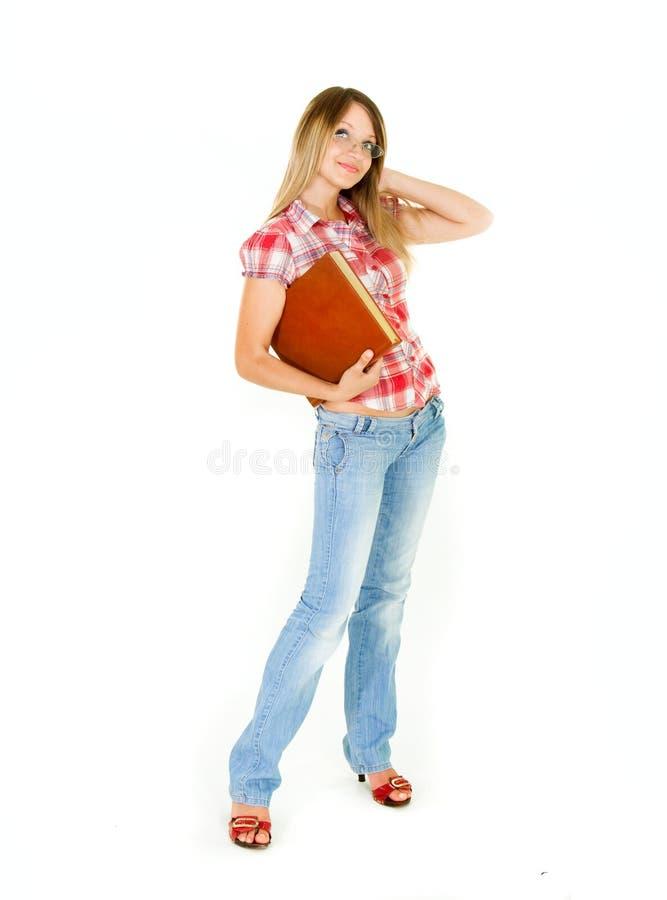 Aantrekkelijk studentenmeisje met groot boek stock afbeelding