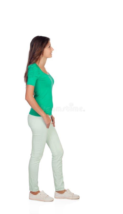 Aantrekkelijk toevallig meisje in groen stock foto