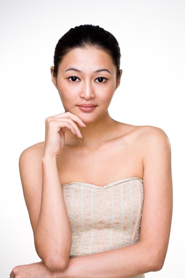 Aantrekkelijke Aziatische jonge vrouw stock afbeelding