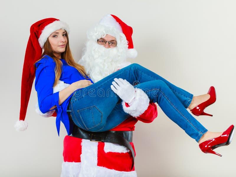 Aantrekkelijke dame met Santa Claus royalty-vrije stock foto