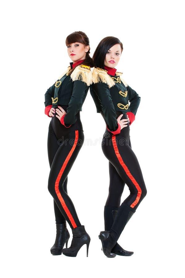 Aantrekkelijke dansers in stadiumkostuums royalty-vrije stock afbeeldingen