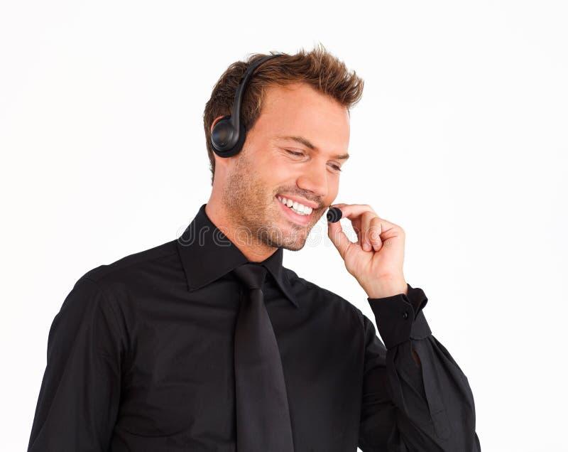 Aantrekkelijke de vertegenwoordigersmens van de klantendienst stock foto